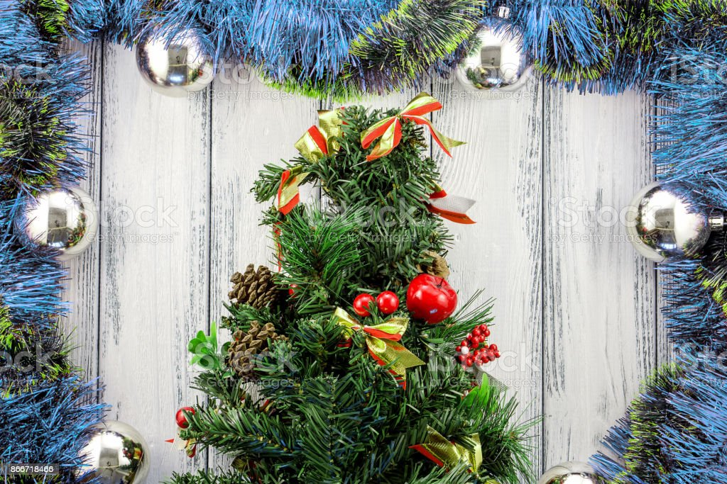 New Year Theme Christmas Tree With Blue Red And Green Decoration And Silver Balls On White Retro Stylized Wood Background Stock Photo Download Image Now Istock