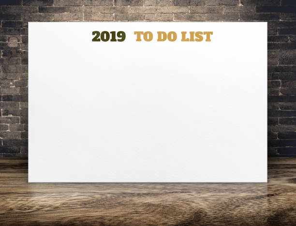2019 new year to do list on white paper poster on brown wood floor room and brick wall,Business presentation mock up for adding your list stock photo