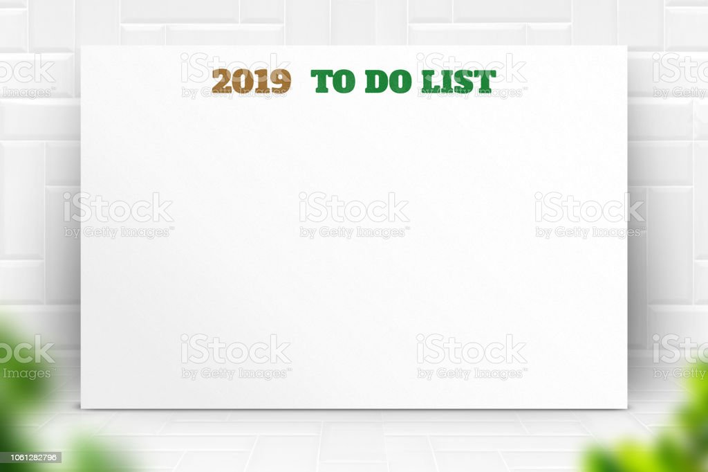 2019 new year to do list text on white paper poster and pencil with...