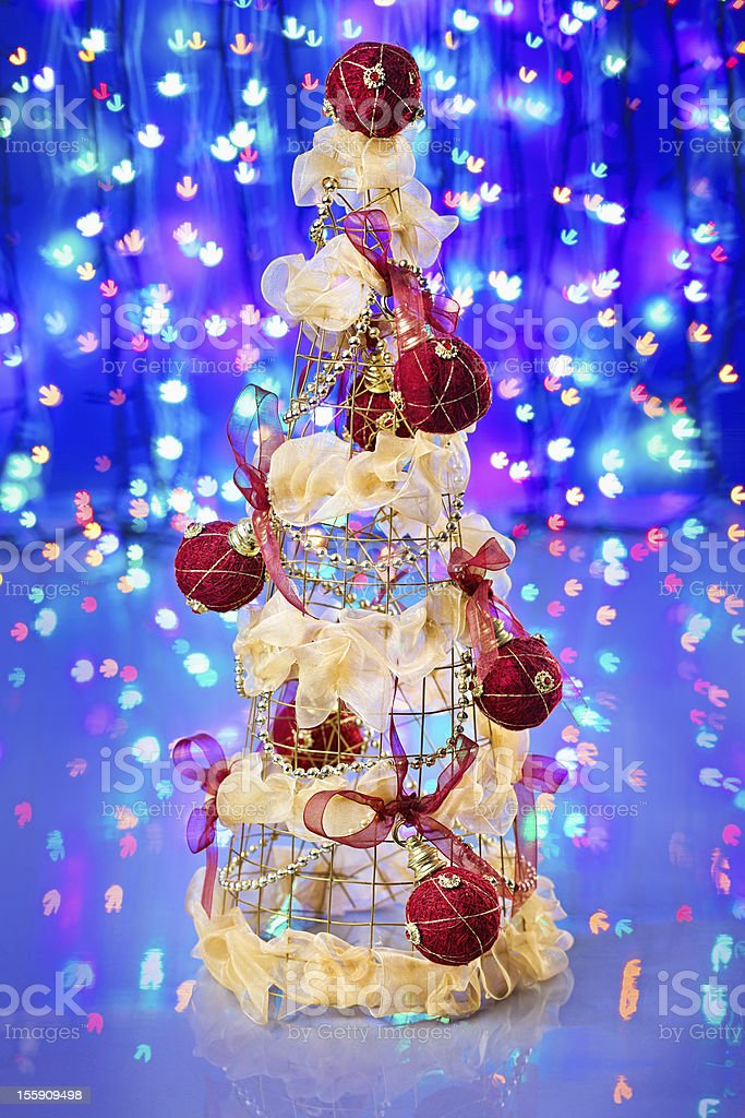 New Year tree decorated on blue sparkling background royalty-free stock photo
