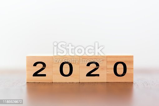 1066508880 istock photo 2020 New year. Wooden cubes on wooden table with copy space 1185526672