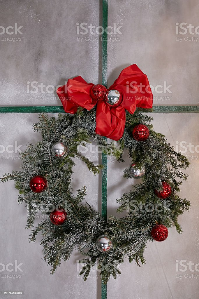 New Year wreath with a red bow and toys stock photo