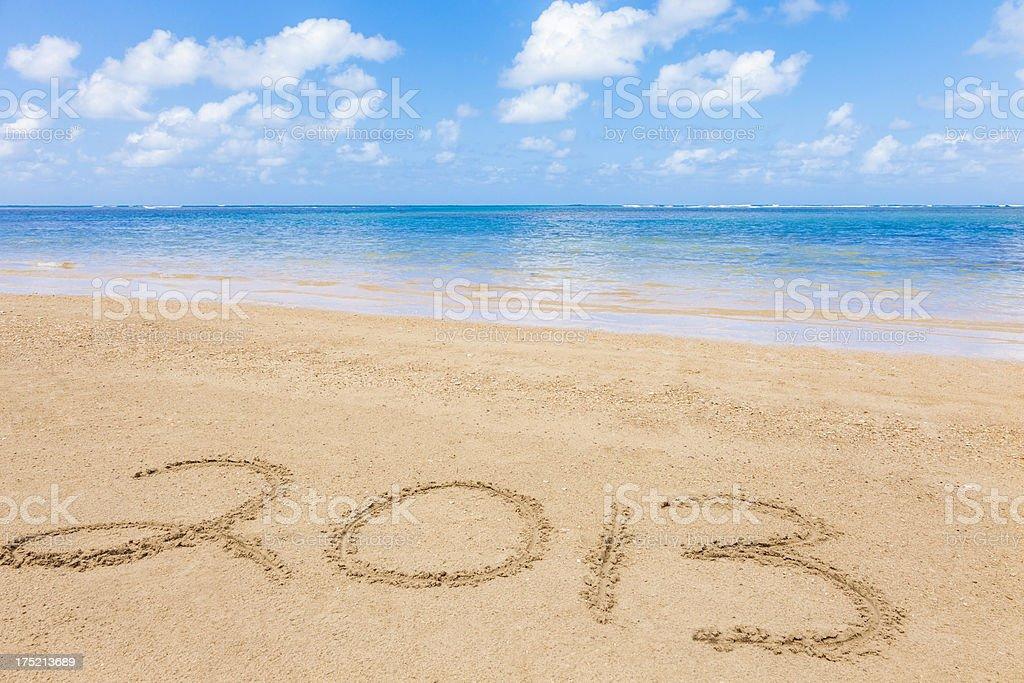 2013 New Year written in tropical beach sand stock photo