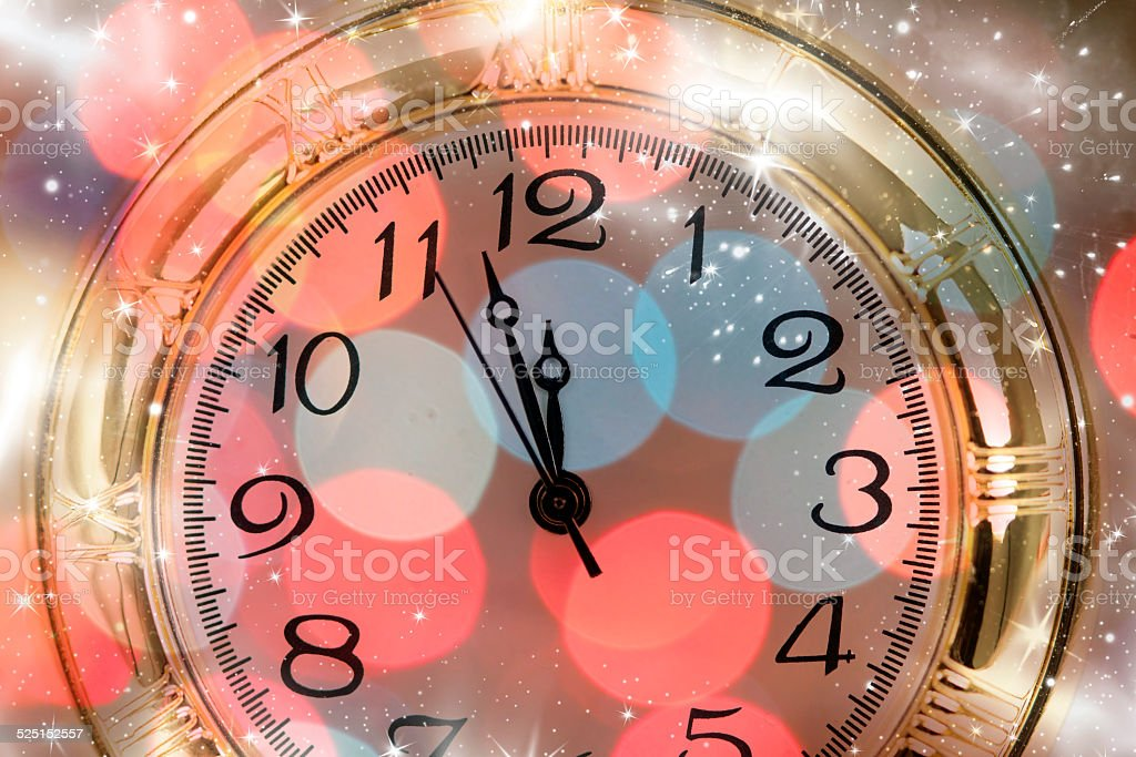 New Year\'s at midnight - Old clock with stars snowflakes and holiday...
