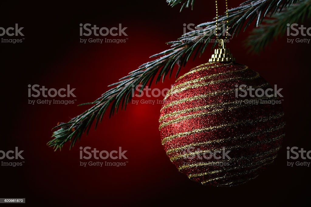 New Year's ball on a dark red background foto royalty-free
