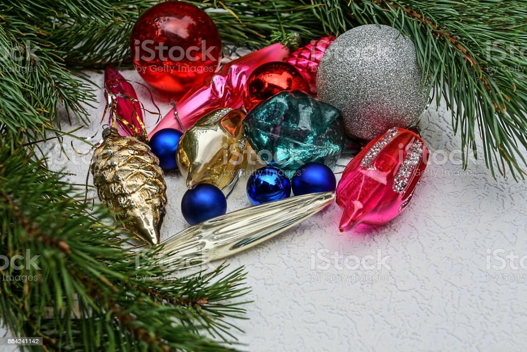 New Year's bright colored toys and pine branches on a gray background royalty-free stock photo