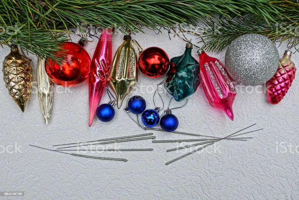 New Year's bright toys with Bengal lights and pine branches on a gray background royalty-free stock photo