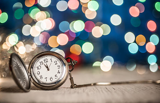 New Year's clock at midnight New year clock on abstract background midnight stock pictures, royalty-free photos & images