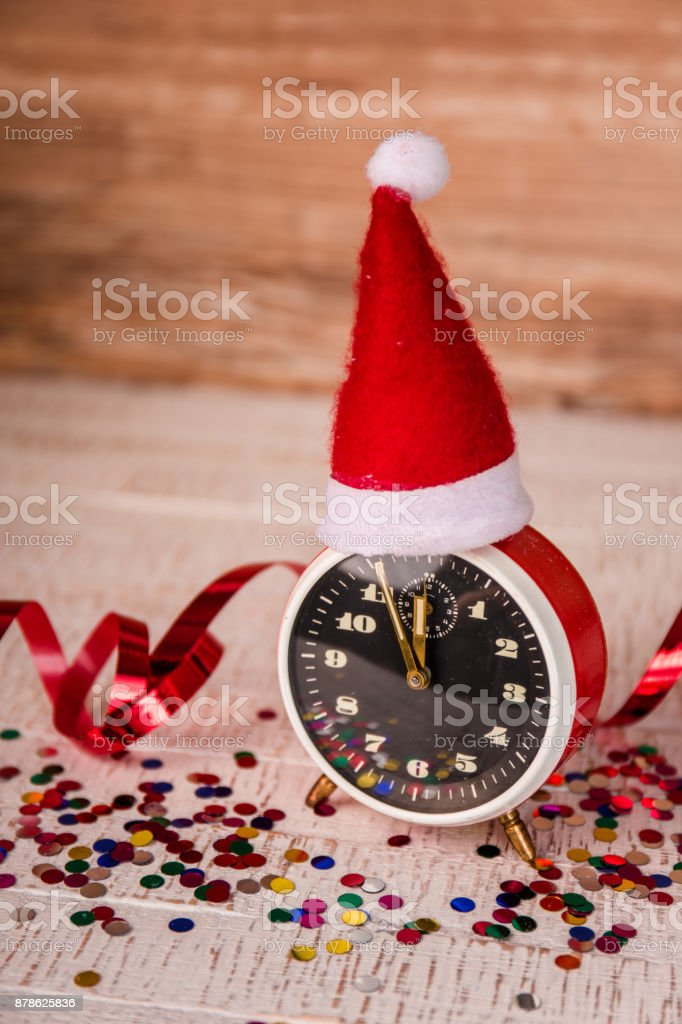 An alarm clock with a Santa hat