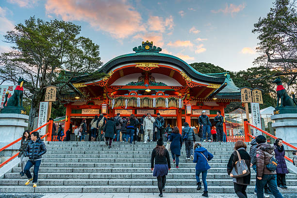 New Year's Day at Fushimi Inari Kyoto, Japan - January 1, 2015: Japanese people enter Fushimi Inari Shrine in the early morning of New Year's Day on January 1, 2015, in Kyoto, Japan. shinto shrine stock pictures, royalty-free photos & images