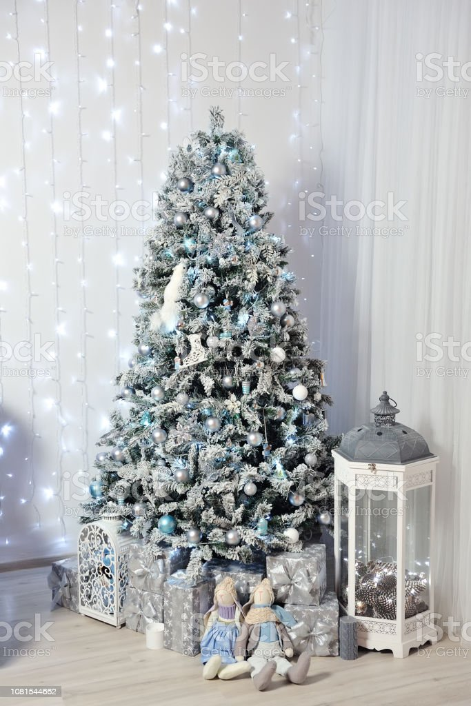 New Years Decor In A Photo Studio In Gray And White A Snowwhite Christmas Tree Gifts And Lanterns Against The Background Of A White Wall Stock Photo Download Image Now Istock