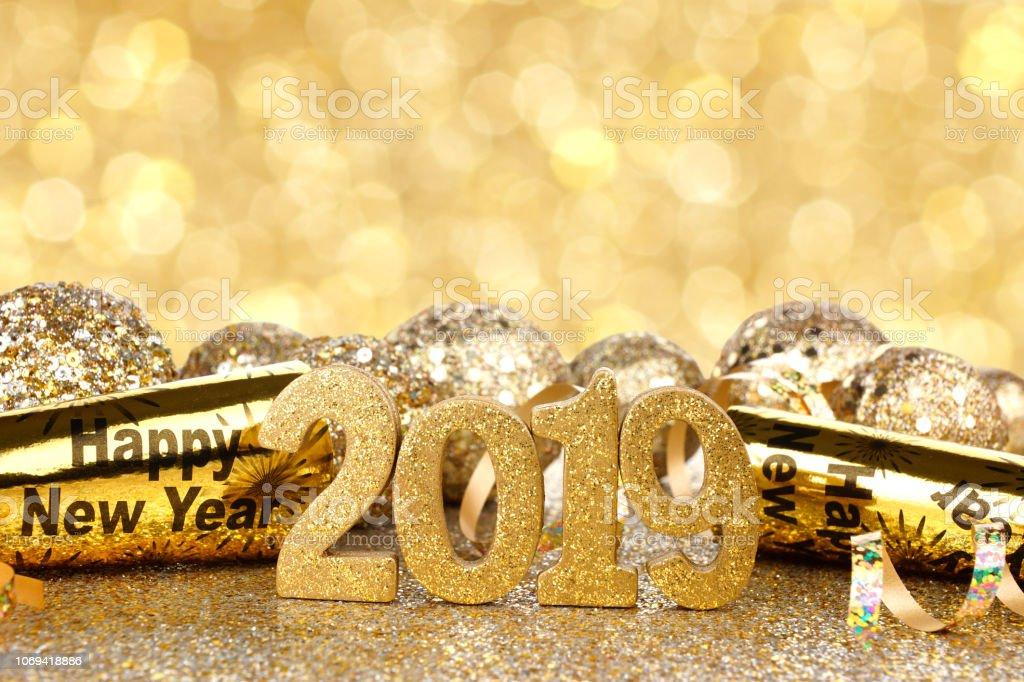 New Years Eve 2019 golden numbers and decorations with twinkling...