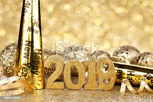 1049972562 istock photo New Years Eve 2019 decorations with twinkling background 1069418924