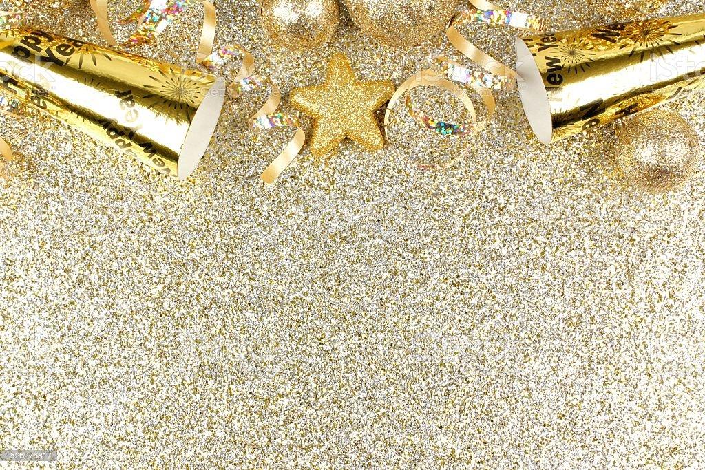 New Years Eve border on shiny gold background stock photo