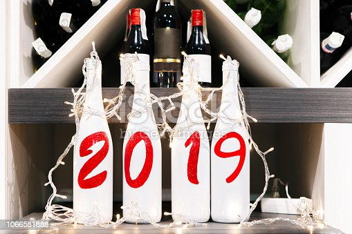 istock New Years Eve celebration background with pair of flutes and bottle of champagne in bucket and a horseshoe as lucky charm 1066581888