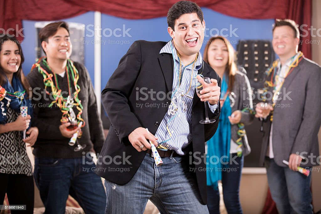 New Year's Eve celebration. Multi-ethnic group of friends. Party. Dancing. stock photo