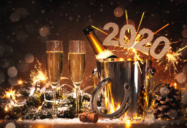 New Years Eve celebration New Years Eve celebration background with pair of flutes and bottle of champagne in  bucket  and a horseshoe as lucky charm new year's eve stock pictures, royalty-free photos & images