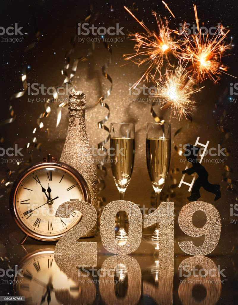 New Years Eve celebration background with pair of flutes, bottle of...