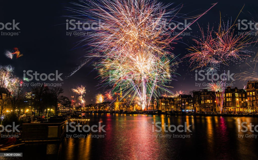 New Year's Eve fireworks over the Amstel River in Amsterdam, North Holland, the Netherlands stock photo
