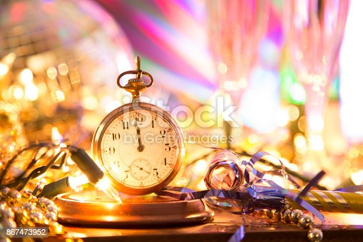 istock New Year's Eve holiday party, pocket watch, clock at midnight. 867473952