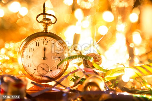 istock New Year's Eve holiday party, pocket watch, clock at midnight. 871015674