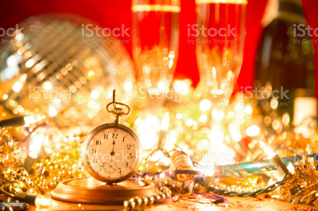 New Year\'s Eve holiday party with sparkling wine, disco ball,...
