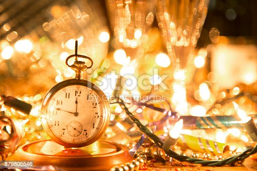 istock New Year's Eve holiday party, pocket watch, clock at midnight. 879805546