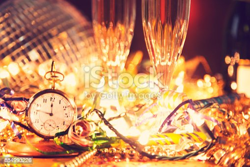 istock New Year's Eve holiday party, pocket watch, clock at midnight. 884993226