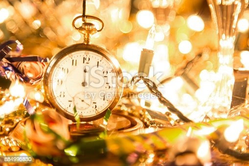 istock New Year's Eve holiday party, pocket watch, clock at midnight. 884995830
