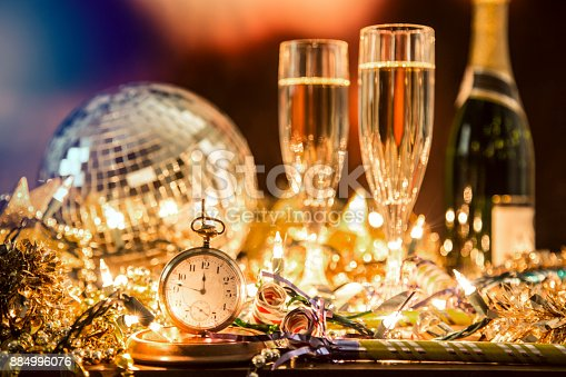 istock New Year's Eve holiday party, pocket watch, clock at midnight. 884996076