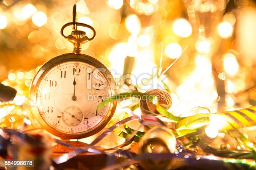 istock New Year's Eve holiday party, pocket watch, clock at midnight. 884996678