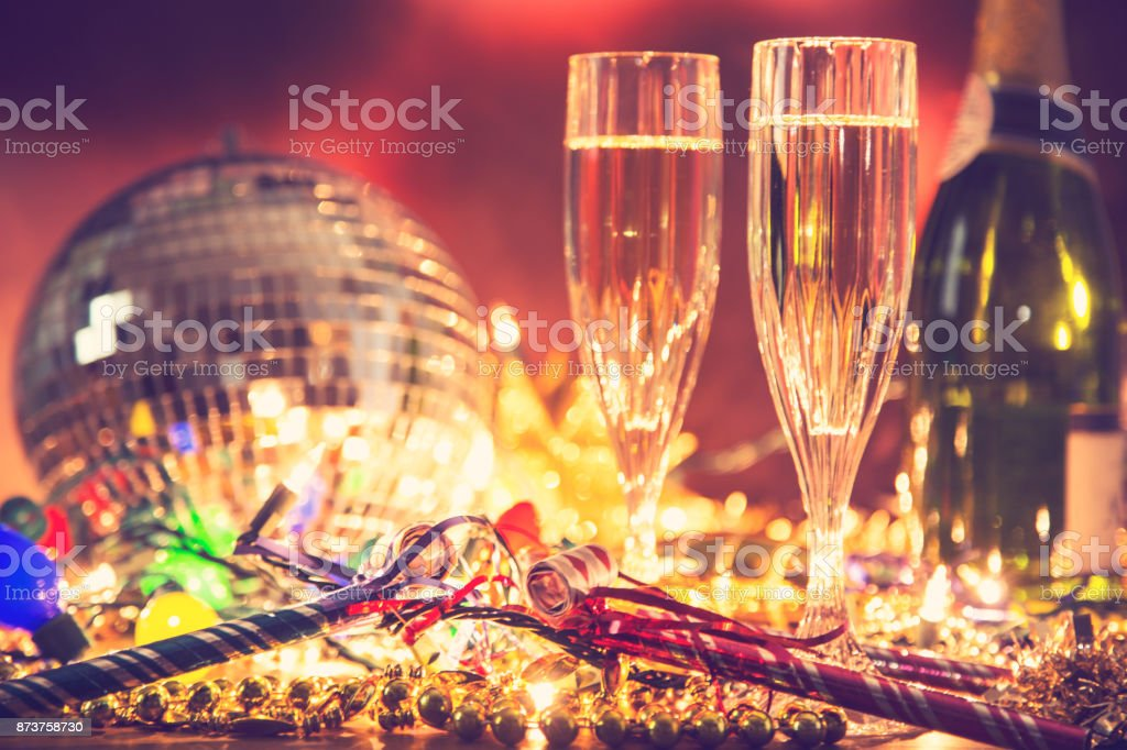 New Year's Eve holiday party with champagne, disco ball, decorations. stock photo