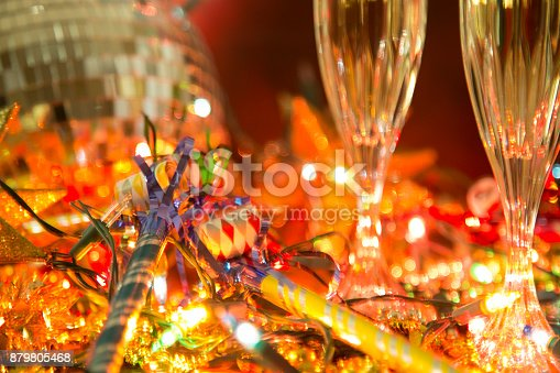 istock New Year's Eve holiday party with champagne, disco ball, decorations. 879805468