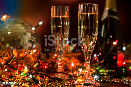 istock New Year's Eve holiday party with champagne, disco ball, decorations. 879805660