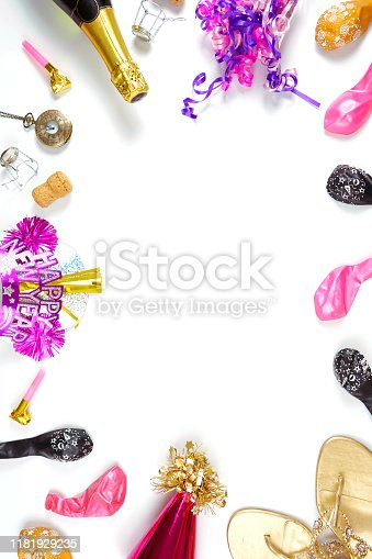 istock New Year's Eve minimal background with champagne and pink and gold decorations. 1181929235