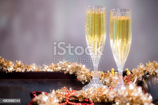 istock New Year's Eve party. Decorations, champagne, tinsel, beads. 490999244