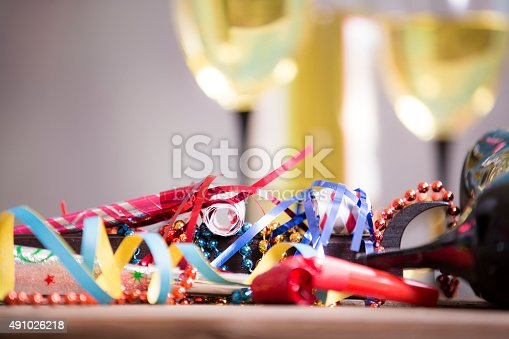 istock New Year's Eve party. Decorations, wine, bottle. Party horn blowers. 491026218