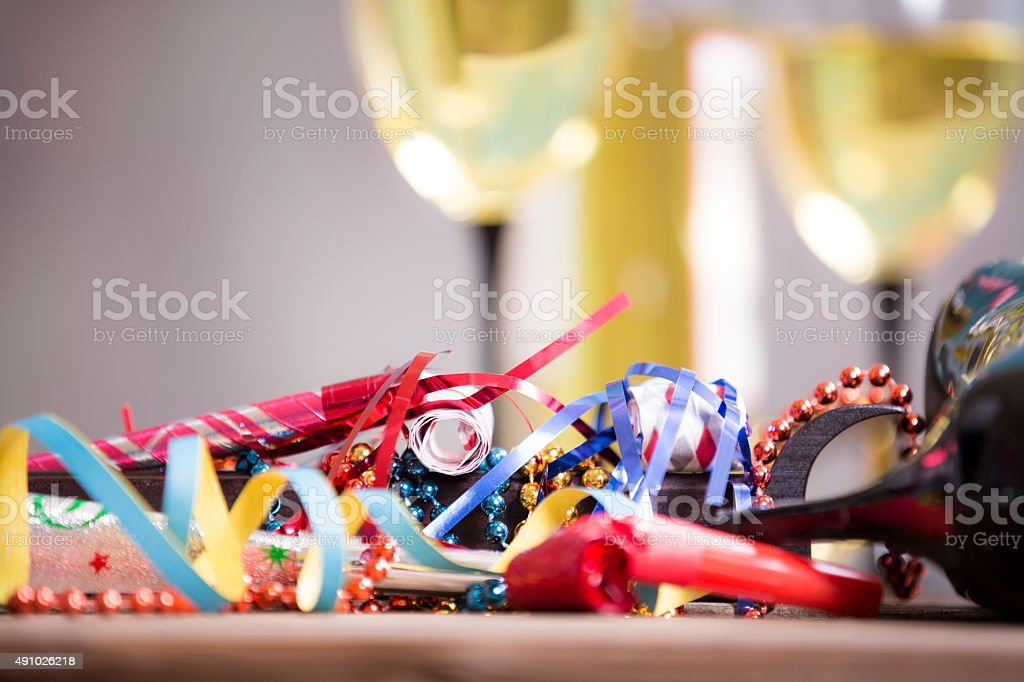 New Year's Eve party. Decorations, wine, bottle. Party horn blowers. stock photo