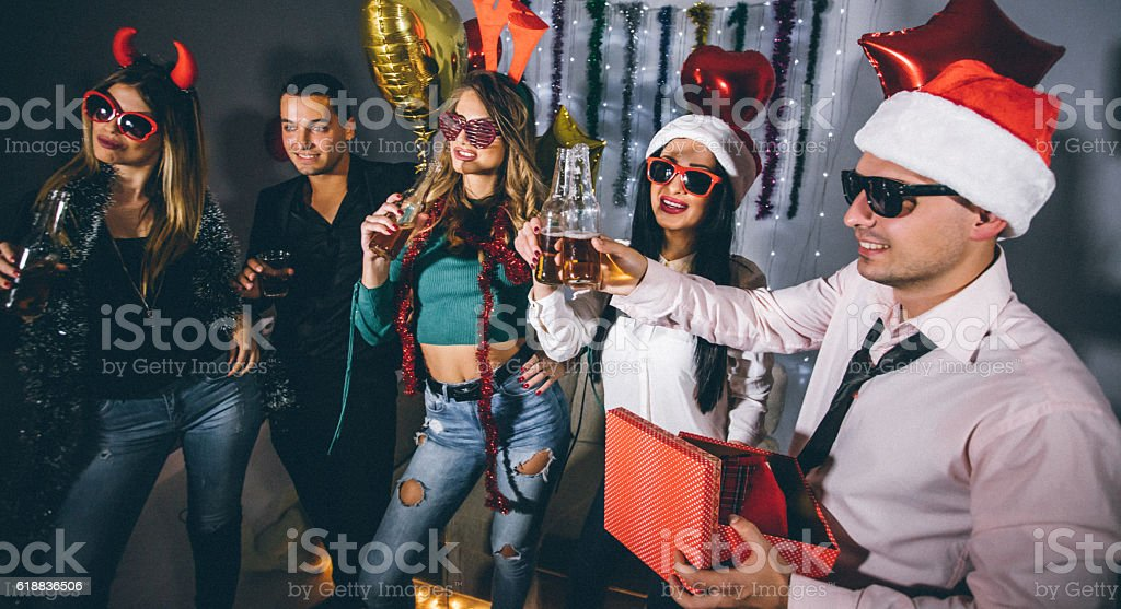 Beautiful young people having a toast at New Year\'s Party