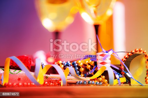 istock New Year's Eve party with decorations, wine. 635674572