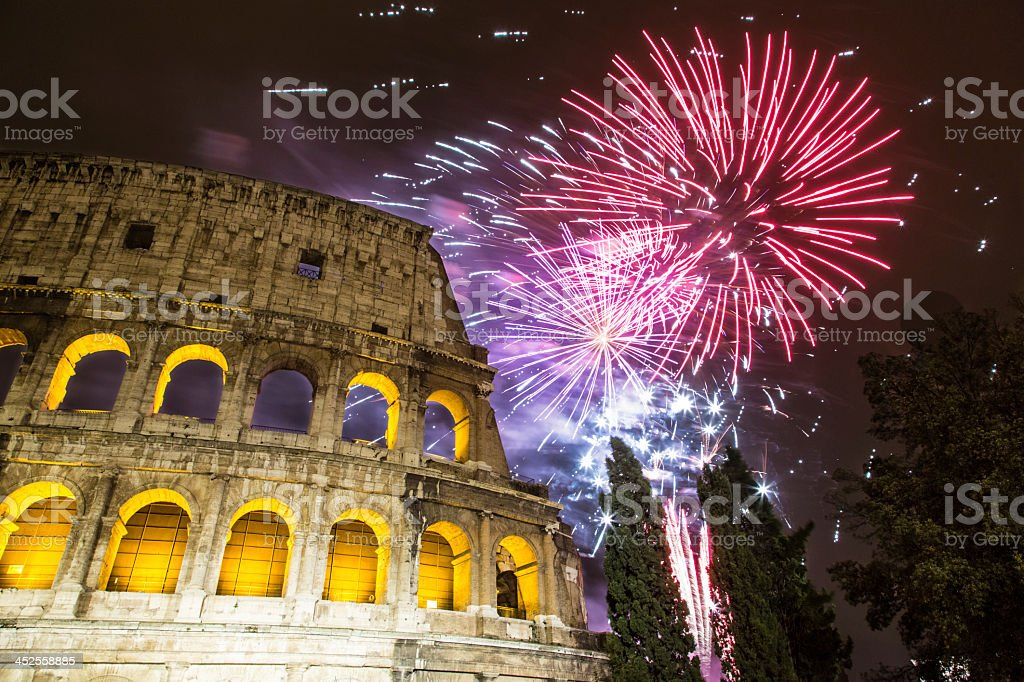 New Year's fireworks in the sky by the Colosseum in Rome stock photo