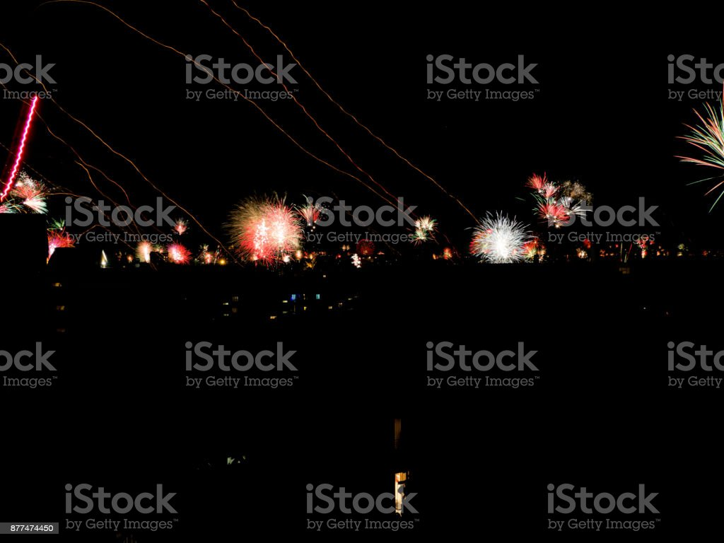 new year's fireworks over the city stock photo