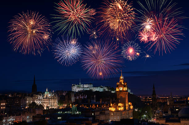 New Years fireworks New Years fireworks over the city of Edinburgh with major famous attractions such as the Castle, Princes Street and other heritage buildings. edinburgh scotland stock pictures, royalty-free photos & images