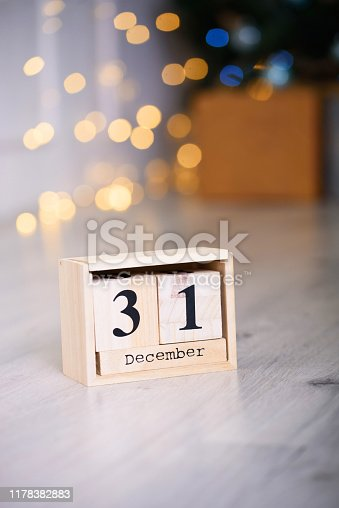 istock New Year's gift with an eco calendar on December 31. New Year content. 1178382883