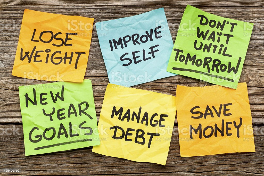 New Years goals or resolutions on sticky notes stock photo