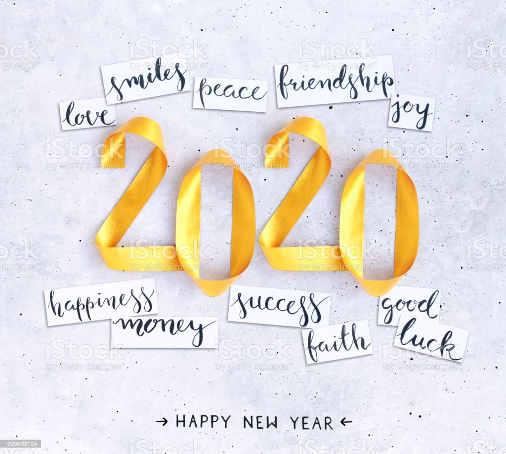 2020 New Year's handwritten wishes with 3D handmade gold painted composition of numbers lying on a concrete background - Royalty-free 2020 Stock Photo