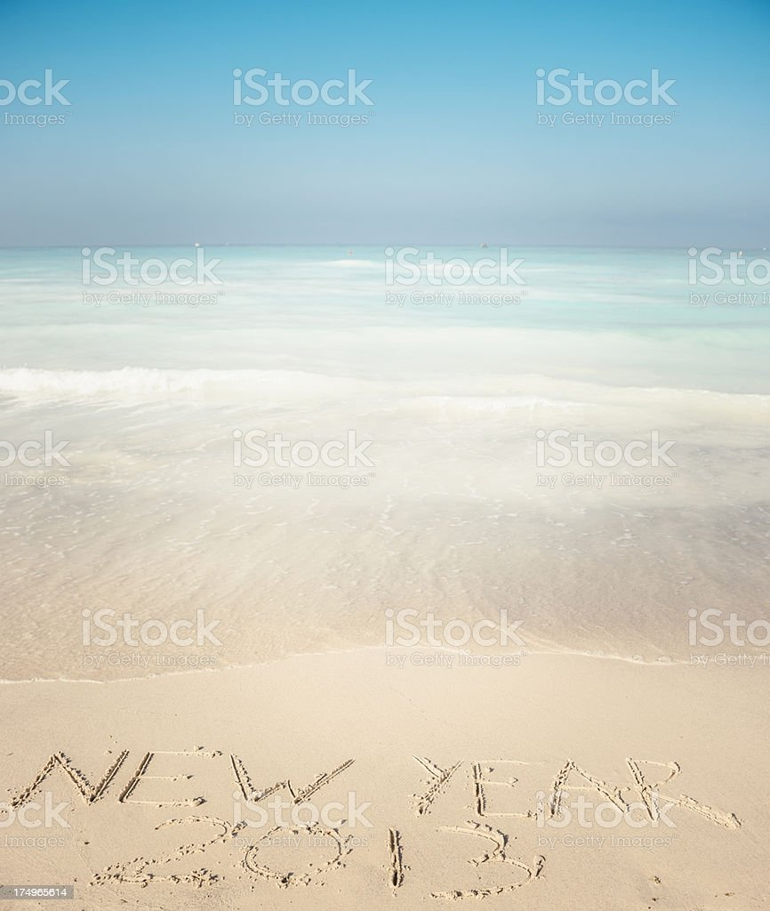 New Year's on the sand beach - 2013 royalty-free stock photo
