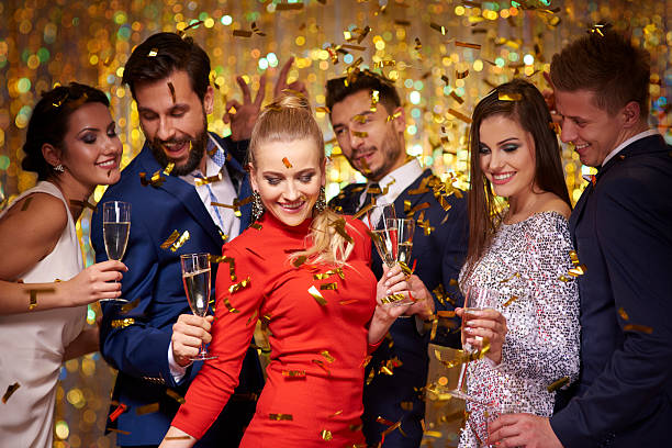 new years party is being celebrated - public celebratory event stock photos and pictures