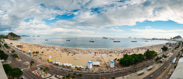 New Years' Party on Copacabana Beach, Rio de Janeiro, Brazil Aerial panorama of Copacabana beach as party-goers wait for the iconic fireworks. Three million people are expected to attend the party, the biggest in the world reveillon stock pictures, royalty-free photos & images