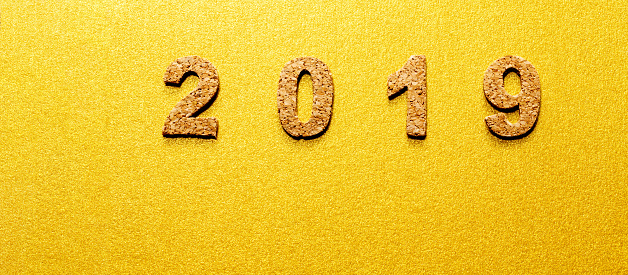 New years resolution 2019 concept cork year number on gold color background with copy space - New years colors 2019 ...